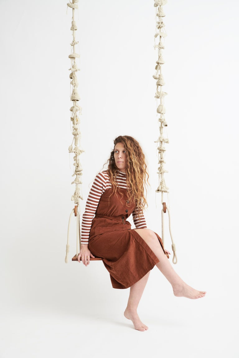 These swings are light, dreamy and perfect for enjoying the outdoors. They are composed of nearly 100 handcrafted elements from a signature UV protected yarn, designed and produced exclusively by iota. The seat of the swing is made of teak