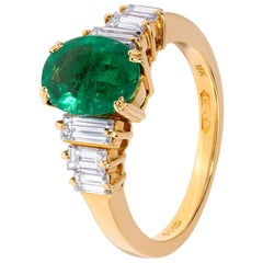 Handmade Emerald Ring with Baguette Diamond Detail in Yellow Gold