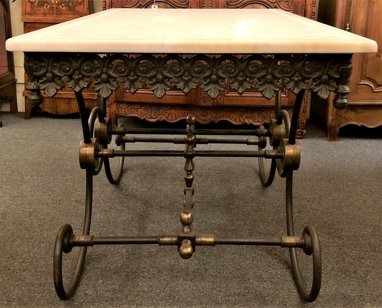 Handmade estate French wrought iron and bronze-mounted butcher or pastry table.