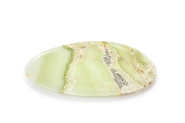 Hand carved presentation plate from Green onyx. Multiple use as plates, platters and placers. The polished finishing underlines the transparency of the onyx making this a very precious object. Dimensions: Big L 36, W 35, H 1.8 cm, also available: