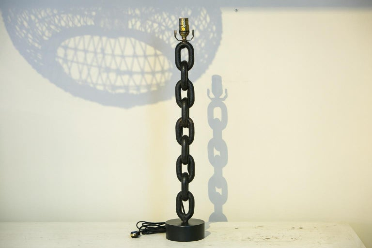 Handmade iron chain table lamp from Belgium. Hand-hammered iron chain links newly wired as a custom table lamp (for use within the USA). Chain's patina is beautiful and lamp stands a total of 29 inches high to top of socket (including base). Lamp