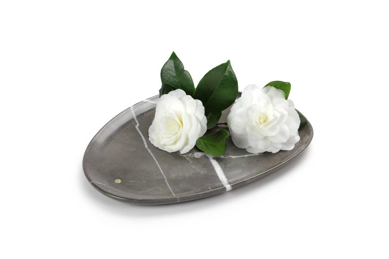 Hand carved presentation plate from Imperial grey marble. Multiple use as plates, platters and placers. Dimensions: Medium L 30, W 28, H 1.8 cm, also available: Small L 24, W 20, H 1.8 cm, big L 36, W 35, H 1.8 cm.  Pieruga proudly creates elegant