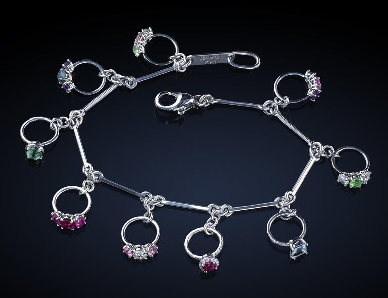 Artist Platinum Charm Bracelet with Miniature Rings Diamonds and Colored Gemstones For Sale