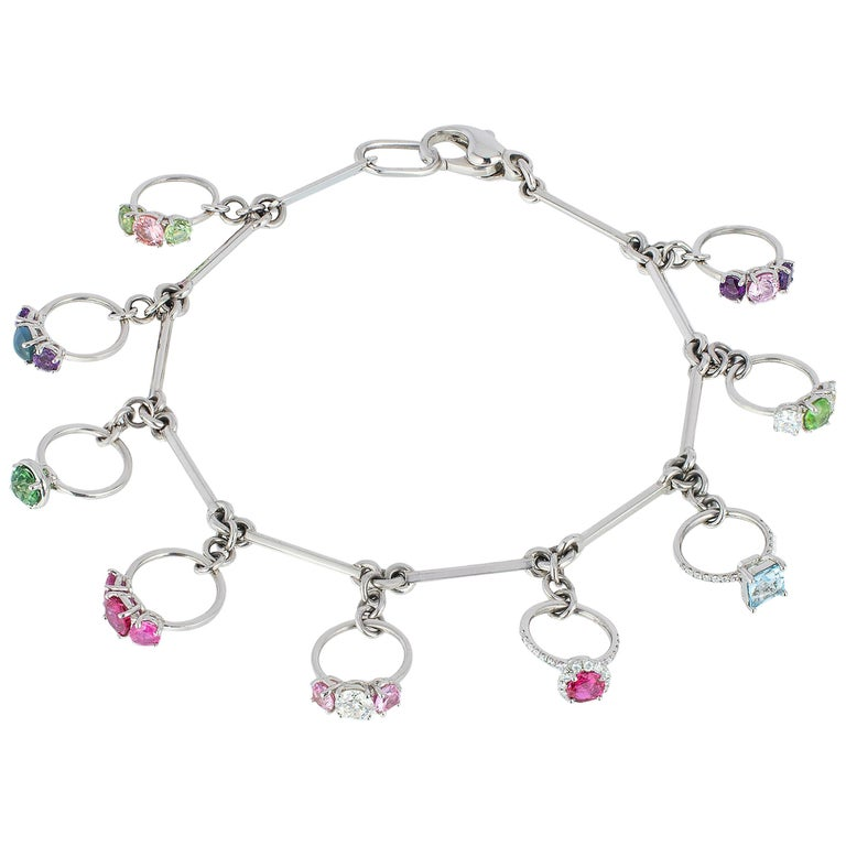 Platinum Charm Bracelet with Miniature Rings Diamonds and Colored Gemstones For Sale