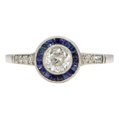 Handmade Platinum Diamonds and Sapphire Halo Ring