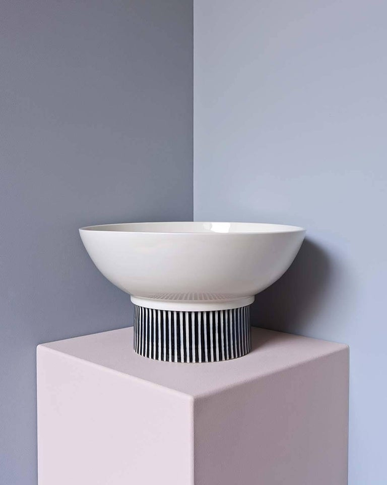 This hand-thrown porcelain Bowl is a contemporary and functional stand out piece. Glossy white porcelain with hand carved stripes on the base. The bowl has a size of diameter 29cm, height 16 cm.   The first Atlas Crafts collection is thrown by