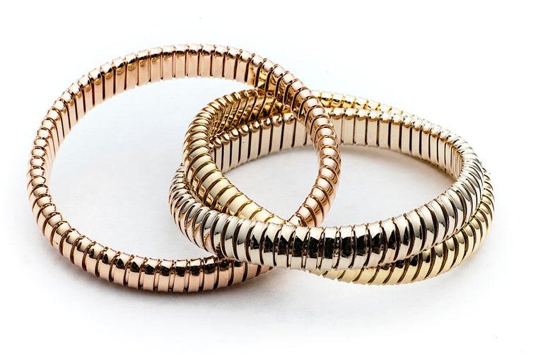 Contemporary Handmade Tri-Color Gold 9mm Three Strand Tubogas Rolling Bangle Bracelet For Sale