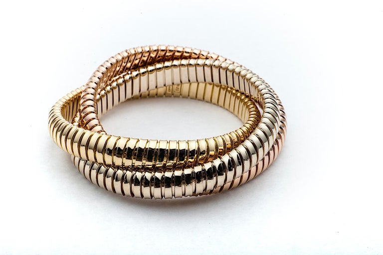 Handmade Tri-Color Gold 9mm Three Strand Tubogas Rolling Bangle Bracelet In New Condition For Sale In Greenwich, CT
