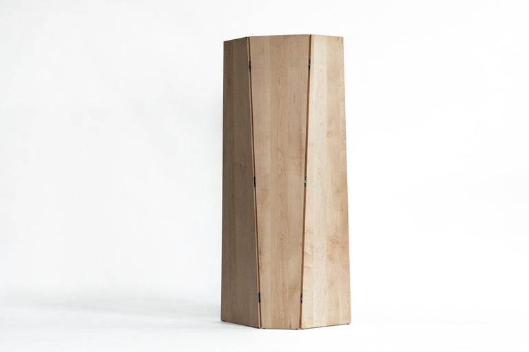 """Sculptural, self-supporting screen for use as a stand-alone or combined to create a larger privacy wall. The tri-fold design can be oriented with the form tapering either up or down.   Shown in solid maple and bronze.  Dimensions: 78"""" height x"""
