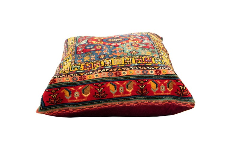 This fantastic floor cushion features a highly detailed geometric design. Hand-knotted with wool, which has been dyed using traditional vegetable dyeing techniques. Decorate your bed, sofa or floor with this fantastic piece as a scatter cushion. Mix