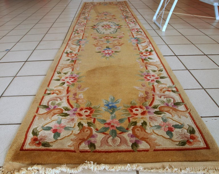 Vintage runner from China made in yellow wool. The rug is from the end of 20th century in original good condition.  - Condition: Original good,  - circa 1970s,  - Size: 2.3' x 9.9' (70 cm x 303 cm),  - Material: Wool,  - Country of origin: