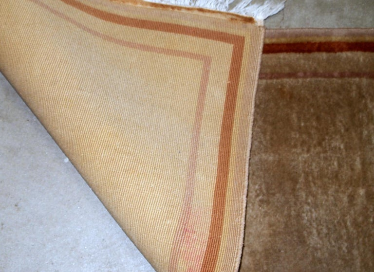 Handmade vintage Chinese rug in beige wool and modern design. The rug is from the end of 20th century, in original good condition.  - Condition: original good,  - circa 1970s,  - Size: 2.1' x 4.2' (64cm x 128cm),  - Material: wool,  -