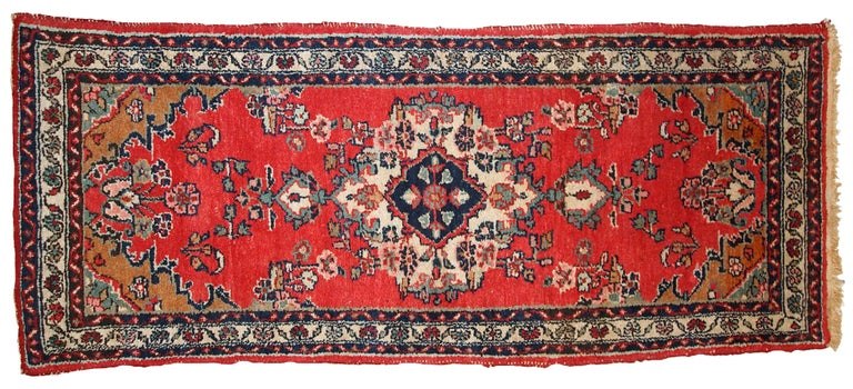 Handmade vintage Hamadan runner in red wool. This rug has been made in the middle of 20th century in Middle East region.  -condition: original good,  -circa 1960s,  -size: 2.6' x 6.3' (81cm x 194cm),  -material: wool,  -country of origin: