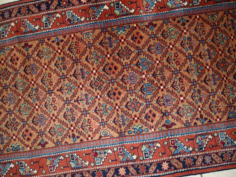 Vintage runner from Middle East in original good condition. It has been made in wool in the middle of 20th century. This runner is machine made.  - Condition: original good,  - circa 1960s,  - Size: 2.6' x 11.3' (79cm x 346cm),  - Material: