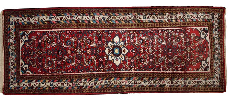 Vintage Persian Hamadan runner in original good condition and in red shade. The rug is thick with the full pile of soft wool.