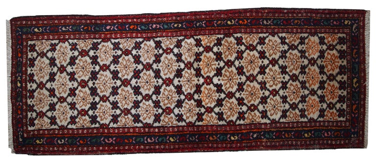 Antique Hamadan runner in good original condition. The rug is in white, red and blue shades. Measures: 2.6' x 6.8' (80 cm x 207 cm).