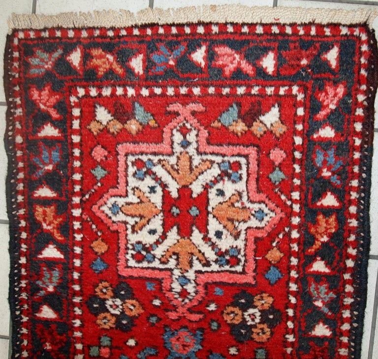 Handmade vintage Karajeh narrow runner in original good condition. The rug is from the middle of the 20th century made in wool.  - Condition: original good,  - circa 1960s,  - Size: 1.9' x 10.2' (57cm x 313cm),  - Material: wool,  -