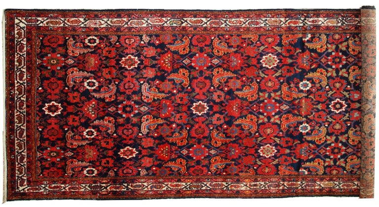 Rare and beautiful antique Malayer runner in original good condition. The rug made in navy blue, red, orange and olive green shades.