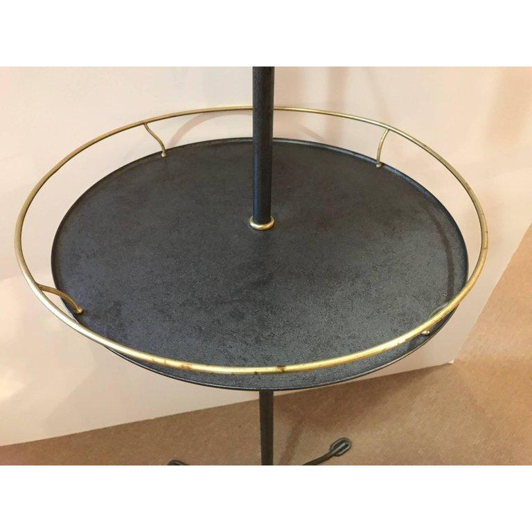 Elegant brass and galvanized metal standing shaving or dressing mirror with shield shaped mirror flanked by two arm candleholders and having a gallery edge table resting on a tripod base.