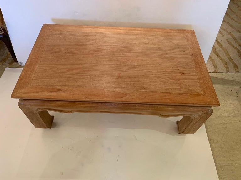 Handsome sturdy cerused hardwood coffee table having classic Asian silhouette with curved pagoda style legs.