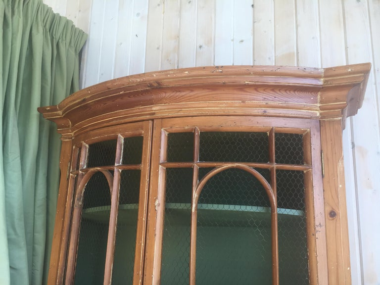 Handsome English pine two-door cabinet with wire mesh on upper doors nice patina Two-door cabinet sits atop a single door base, Measures: Overall 86.5