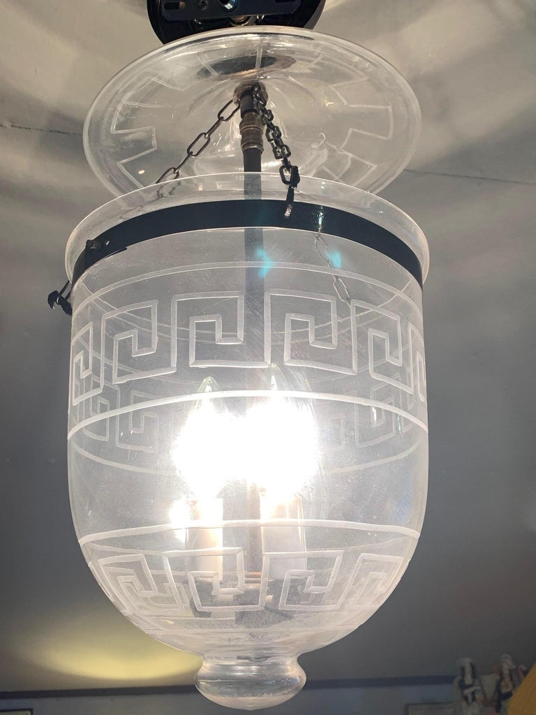 A great looking hall or foyer lantern having handsome Greek key etched design. 3-light inside and metal canopy. Chain not included.
