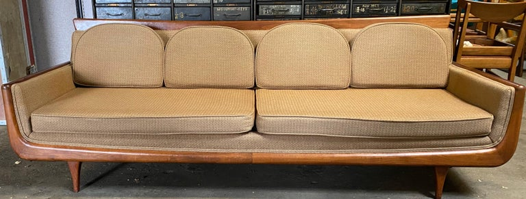 Handsome Mid-Century Modern sofa. Manner of Adrian Pearsall, unusual sculptural walnut frame. Designer. Maker unknown, retains original light brown wool fabric. In amazing condition, superior quality and construction. Classic Mid-Century Modern