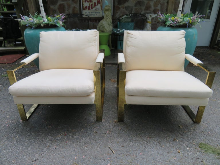 Handsome pair of Milo Baughman brass cube chairs. This pair will need to be re-upholstered so now is your chance to get exactly what you want as far as upholstery-we do have an upholstery service. Examples of authentic vintage Milo Baughman cube