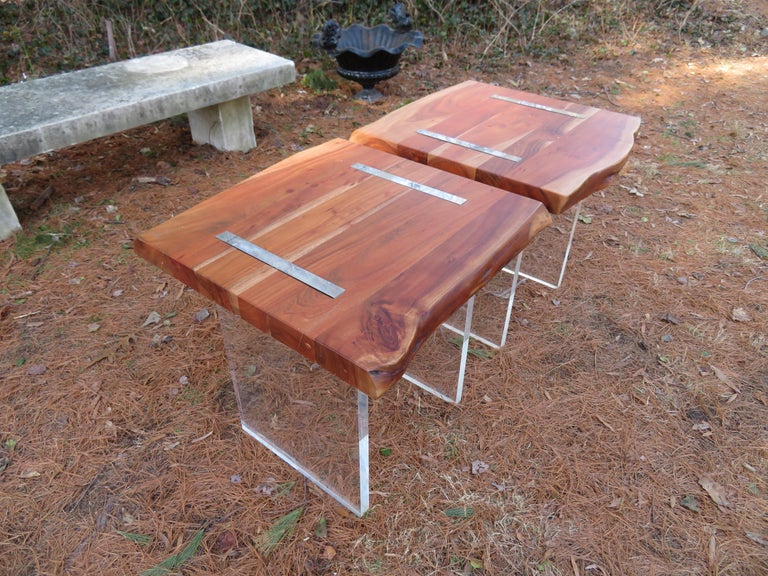 Handsome pair of Nakashima style thick walnut live edge side tables with chunky thick Lucite slab bases. These table are quite substantial in size measuring 24.5
