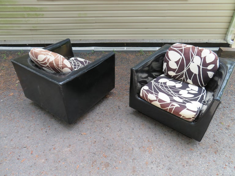 Handsome pair of signed Selig cube lounge chairs in they style of John Van Koert. We love the unique curved u-shaped backs along with the original black and white linen seat cushions. The original upholstery does show wear with some fading to the
