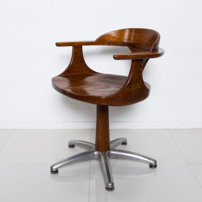 Good looking and very handsome restoration hardware vintage solid oak captain's desk chair office task use Swivel function with continuous arm and aluminum base. Label present. Measures: 31