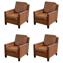 Handsome Set of Four English Library Style Club Chairs with Lovely Worn Patina