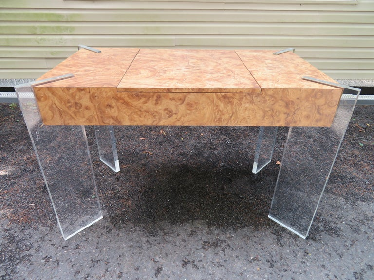 Handsomeburl laminate game table with thick Lucite slab legs. We love the burl laminate as opposed to real wood-kid and adult friendly. This piece can be used as a petite desk with removable top on and backgammon table with top off. The original