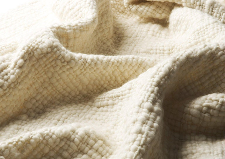 This 100% baby merino organic wool throw is heavenly soft and with a large open weave that creates a unique texture, making it warm and cozy and highly decorative as well. It's the perfect cruelty free non fur alternative to lambskin pieces that are