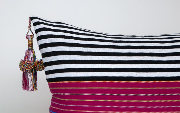 These delightful pillows are made in the Nachig municipality of Zinacantan, Mexico, an area that has been characterized by their finely woven striped ponchos and huipiles, these pillows are created on back strap looms using age old methods and out