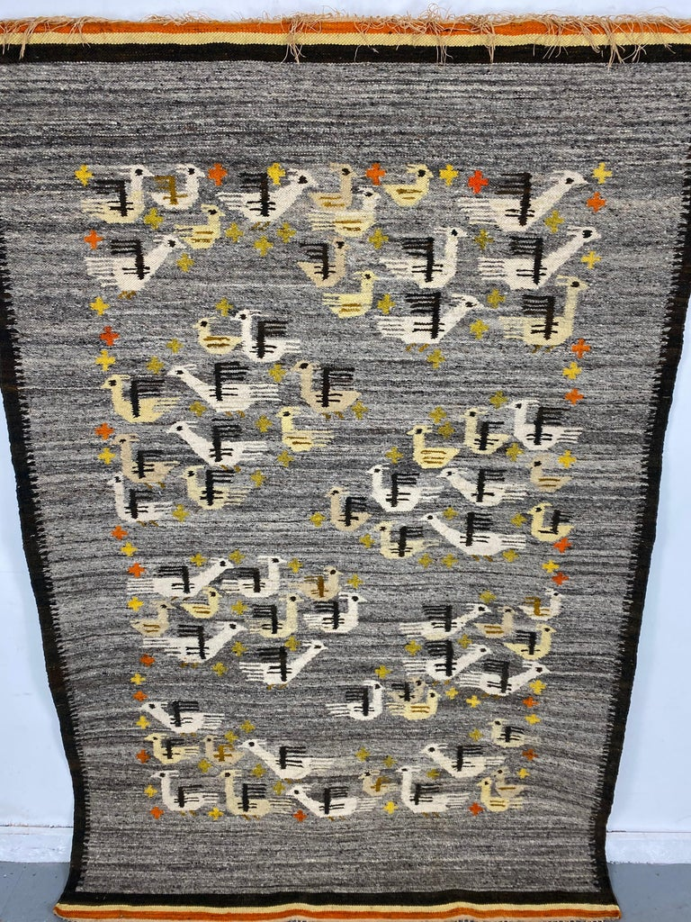 Handwoven midcentury Swedish rug or wall hanging with stylized bird design, this weaving has been set up as a wall hanging, Size: 49