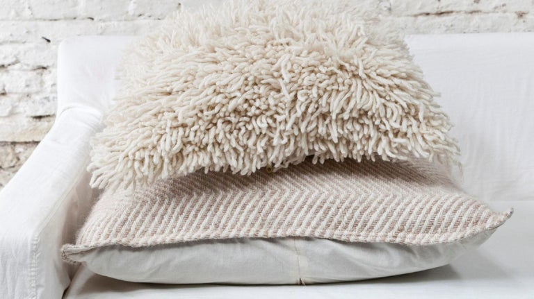 This fantastic Sur style throw pillow is made from hand spun virgin sheep wool, woven by hand by master weavers who live in the remote area of La Puna, Argentina, using ancestral techniques. The entire process from shearing to final finish is done