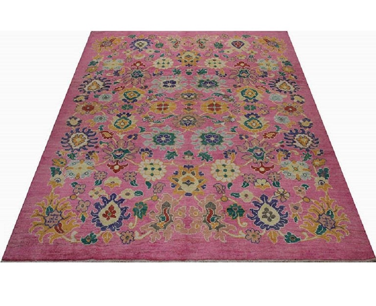 This traditional handwoven Persian Sultanabad rug has been recreated from an antique design. Handwoven in modern-day Iran, this elegant piece is a compelling work of art for the interior designer wanting a simple but striking foundation for their