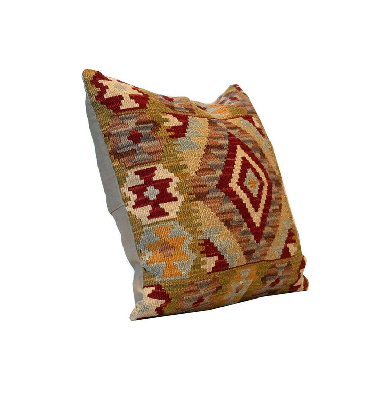 This traditional Kilim cushion cover has been handwoven with the traditional Kilim, flat-weave technique. featuring a geometric pattern woven in beige, cream, blue and red. Decorate your bed, sofa or armchair with this fantastic piece as a scatter