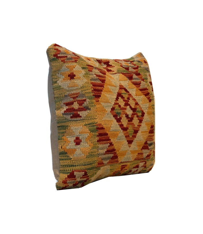 This Traditional Geometric Kilim cushion cover has been handwoven with the traditional Kilim, flat-weave technique. Featuring a geometric pattern woven in brown, red, blue, green and mustard. Decorate your bed, sofa or armchair with this fantastic