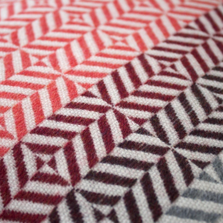 Drawing inspiration from the color and pattern found in stain glass work, the Uccle cushion takes its name from an area of Brussels renowned for its Art Deco architecture.  Handwoven on a dobby loom in our studio using soft merino lambswool and a