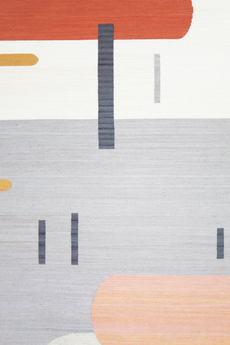 This rug is a one of a kind heirloom piece. Inspired by movement, the asymmetrical design is meant to enhance the flow of any space. With references to both Art Deco and contemporary design elements, this piece will stand out as an addition to any