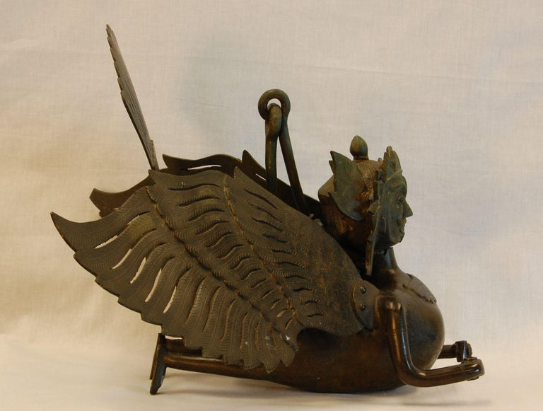 Large, heavy, hanging bronze incense burner in form of ancient Garuda figure. A very ornate and finely etched figure. Origin and exact age unknown. Purchased in 1962 from Madame Ray Paioss of Old Versaille antiques in New York City. This figure is