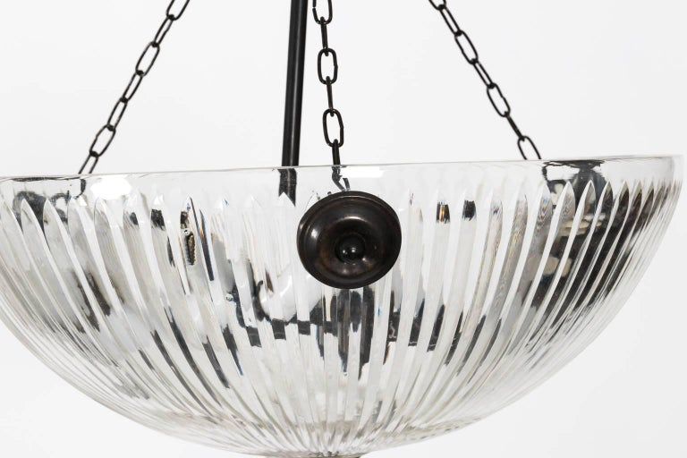 Hanging cut-glass light in a distressed bronze finish, circa mid-20th century.