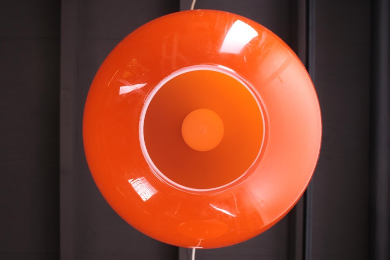 Beautiful orange hanging lamp, this model is also called Ui. (The shape of an Onion). These lamps are mouth blown and this is also called Murano glass. The inside is always white. This lamp unfortunately no longer has stickers of