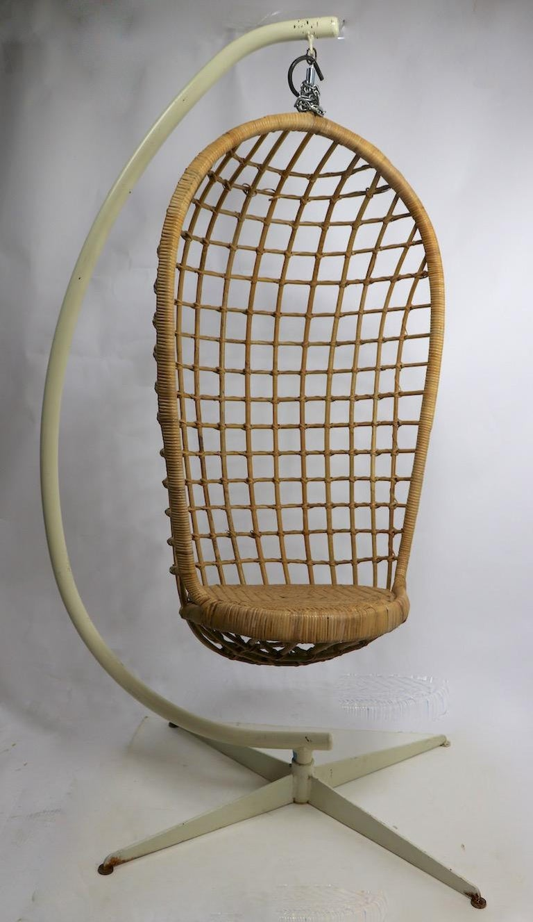 Mid-Century Modern Hanging Wicker Pod Chair with Original Metal Stand For Sale