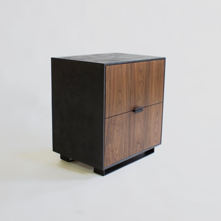 Hanks Nightstand  by Crump and Kwash   Solid wood fronts / honed concrete case / choice of integral color / blackened steel base / blackened steel pulls / dovetailed solid wood drawer boxes / premium soft close hardware   Dimensions: 22 W x 24 H x
