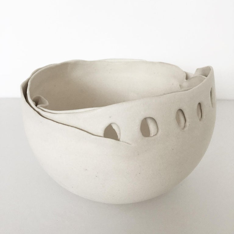 Sculptural studio pottery porcelain bowl by Hannelore Fasciszewski, circa 1980s. Hannelore studied at Center for Creative Studies and Michigan State University Pewabic Pottery in Detroit. Her hand-built forms are generally inspired by creatures that