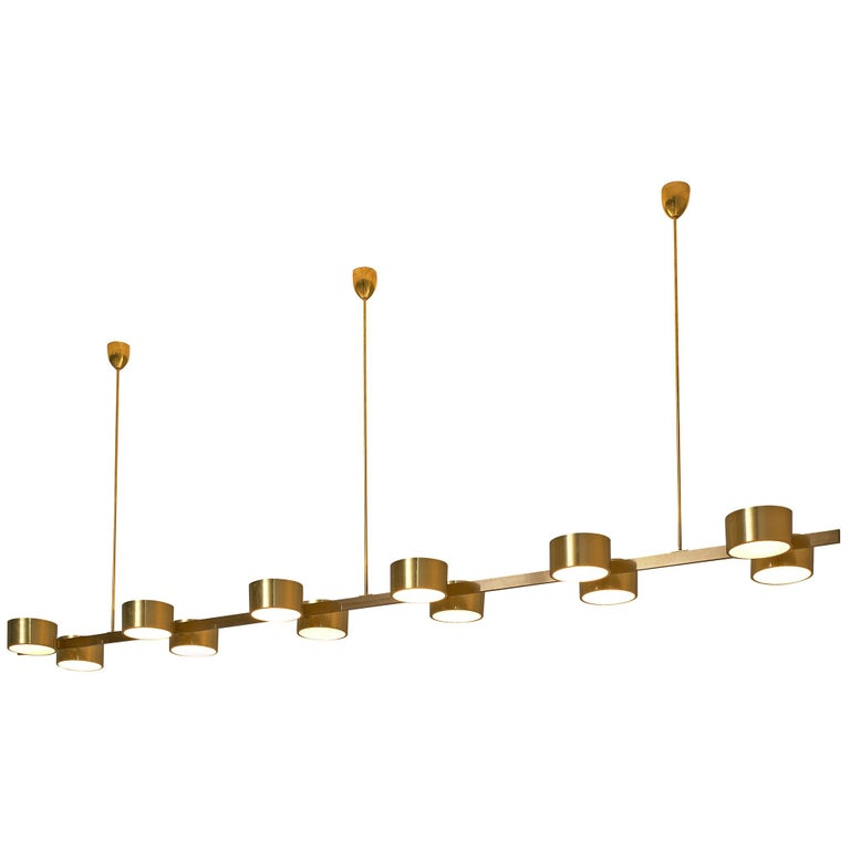 Hans Agne Jakobsson Chandelier with twelve Shades in Brass For Sale