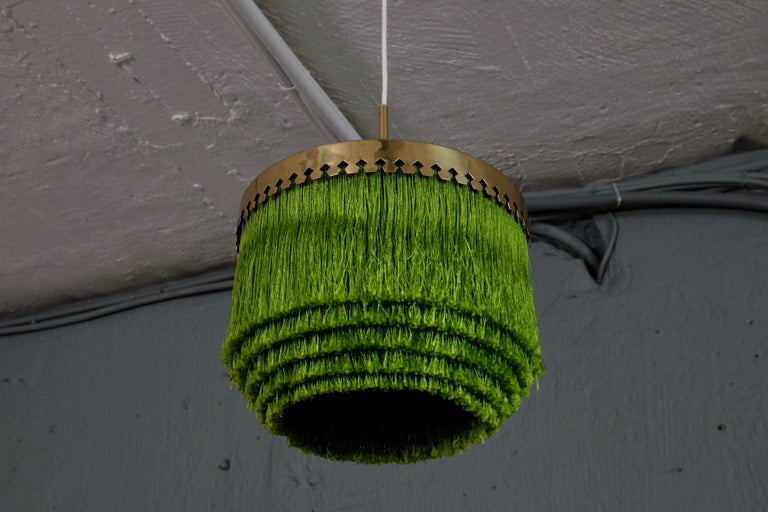 Green fringes and brass.